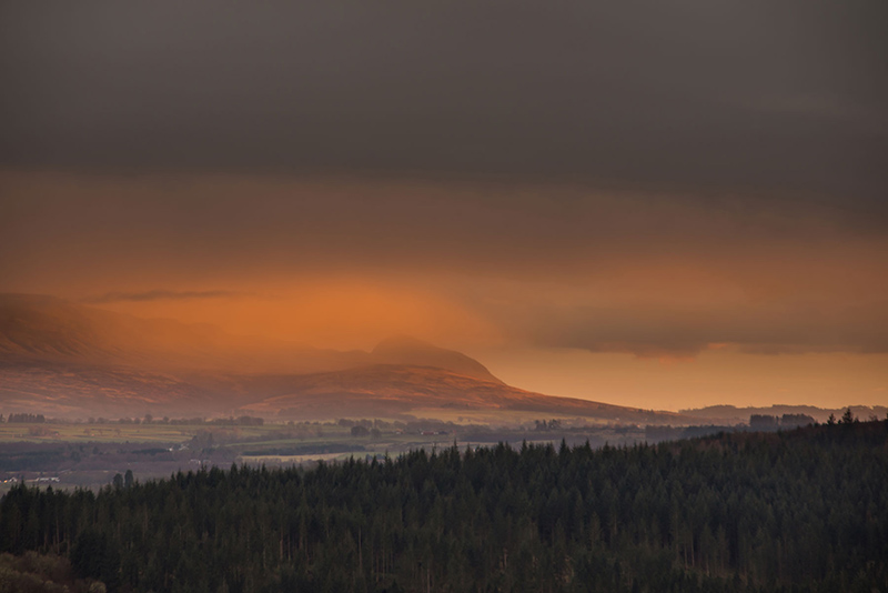 view towards the Campsie Fells under red clouds